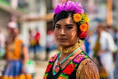 A muxe (pronounced mu-shay) youth takes part in a procession during the Vela de las Intrépidas festival in Oaxaca, Mexico. Muxe identities are diverse and layered and have been part of Zapotec society since pre-colonial times. Jan Sochor/Alamy Stock Photo
